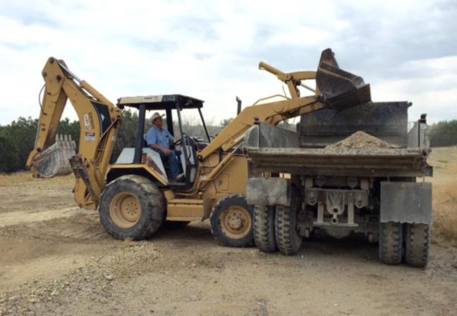 Chris loading dirt